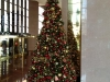 Red, White and Gold Ornament Christmas Tree in Lobby