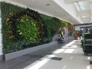 workers maintaining green wall